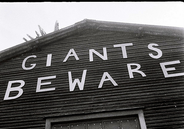 "Sign on barn ""Giants Beware"""